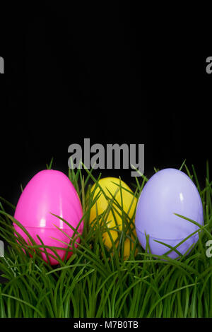 Close-up of Easter eggs in grass