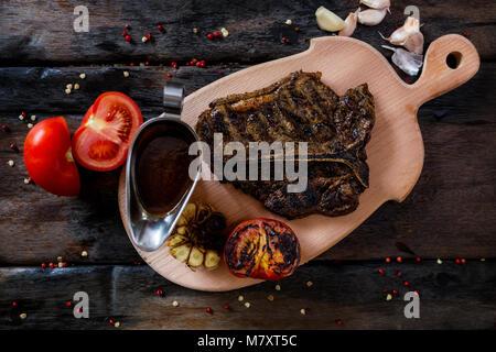 Porterhouse Steak Barbecue bien fait degré de torréfaction Banque D'Images