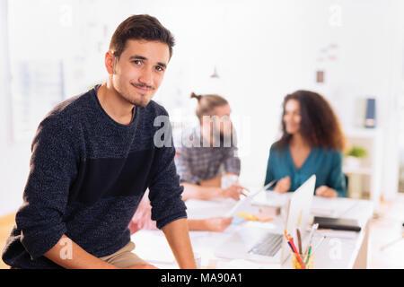 Au bureau. Portrait of a young man
