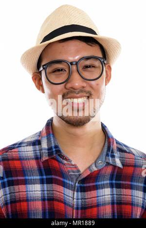 Face à de jeunes professionnels Asian man smiling tout en portant des lunettes un Banque D'Images