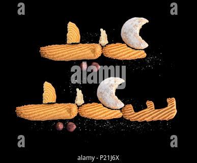 Heureuse fête musulmane, Eid Al-Fitr cookies et biscuits Greeting sur noir Banque D'Images