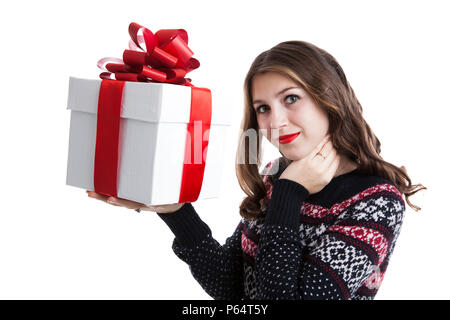 Girl in sweater holding gift boxes on a white background Banque D'Images