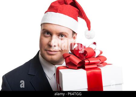 Homme tenant une boîte-cadeau sur fond blanc Banque D'Images