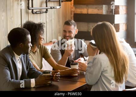 Smiling friends enjoying time together in cafe Banque D'Images