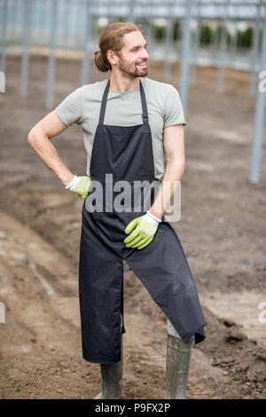 Agriculteur dans la serre Banque D'Images