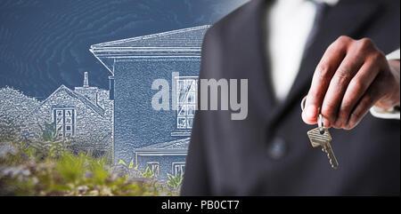 Composite image of a businessman holding a key Banque D'Images