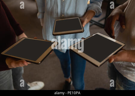 Executives using digital tablet in l'office