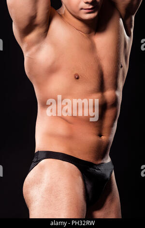 La flexion des muscles de l'athlète. Banque D'Images