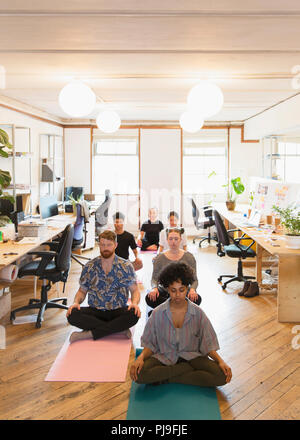 Serene creative business people in office Banque D'Images