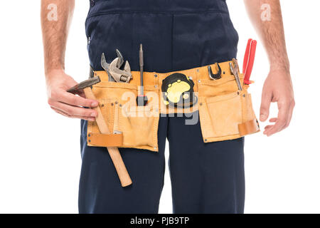 Réparateur cropped shot of wearing tool belt isolated on white Banque D'Images