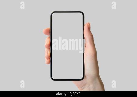 Main tenant cadre avant-free   tissu smartphone moderne en face de fond  neutre Banque f1145da2d5fc