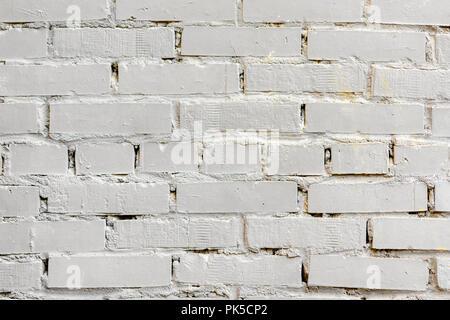 Peint en blanc à la surface de la brique, contexte urbain. Texture grunge graphique. Pour abstrait toile, motif, design de bannières Banque D'Images