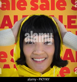 Image composite de femme portant imperméable jaune contre fond blanc Banque D'Images