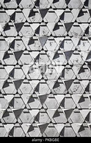 Mur de briques de forme triangulaire ou la texture.