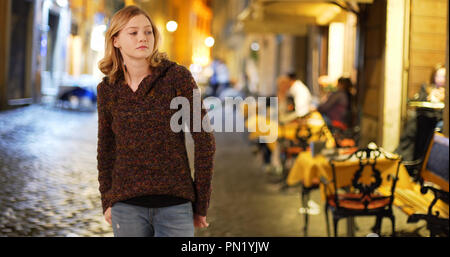 Pretty Caucasian girl on urban street at night Banque D'Images