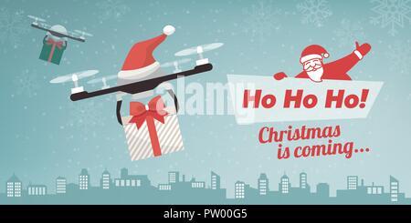 Avec les drones Santa's hat offrant des cadeaux de Noël dans la ville, la neige qui tombe et le texte Banque D'Images