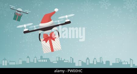 Avec les drones Santa's hat offrant des cadeaux de Noël dans la ville et la neige qui tombe Banque D'Images
