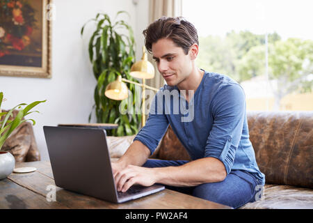 Young Caucasian man using laptop in a Coffee shop
