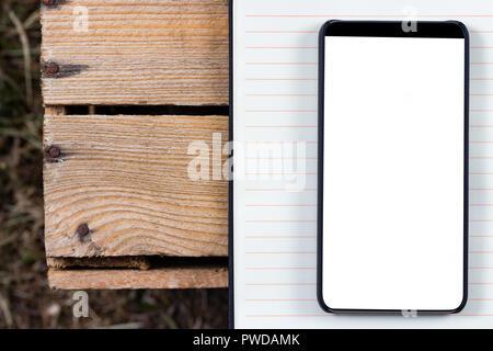 ... Le bloc-notes et le cadre moins Smartphone avec écran vide. Prêt pour la e8e1b4d6607c