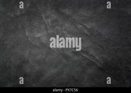 Texture ardoise noir gris foncé, floortile, papier peint ou l'arrière-plan. Texture rugueuse avec des détails fins. Banque D'Images