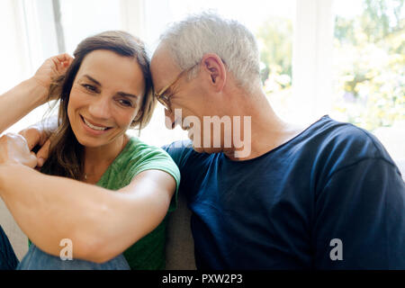 Mature Woman sitting on sofa at home