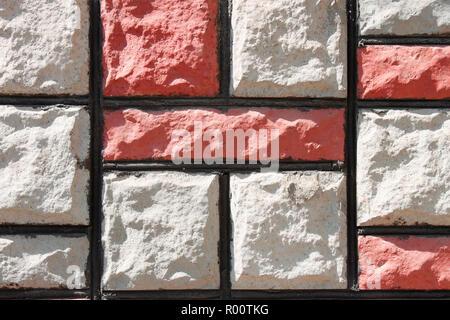 Détail de mur de pierres décoratives colorées couvrant Banque D'Images