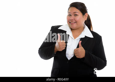 Studio shot of young happy fat Asian businesswoman smiling while Banque D'Images