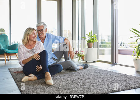 Smiling young couple relaxing at home