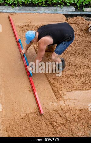 Concretor dalle de béton fraîchement coulé de mise à niveau