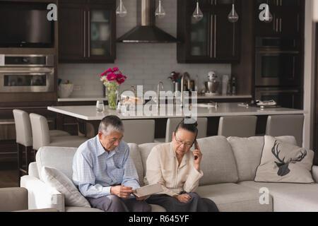 Senior couple talking on mobile phone