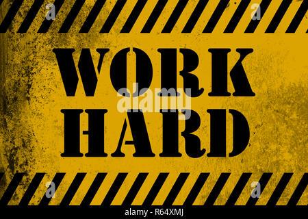 Travailler dur avec bandes jaune signe Banque D'Images