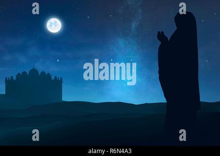 Silhouette de femme musulmane la main et prier