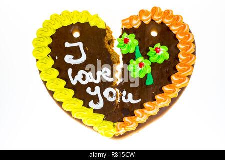 """Broken gingerbread heart avec le message """"I love you"""", image symbolique de séparation ou de divorce Banque D'Images"""