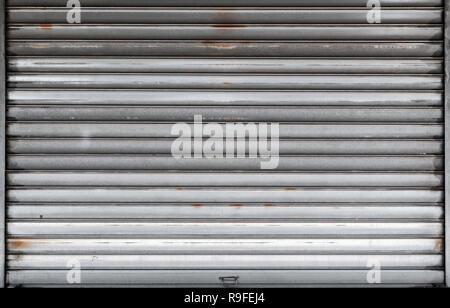 Porte de garage fermé, porte rouleau de métal rouillé, texture de fond photo, vue de face Banque D'Images
