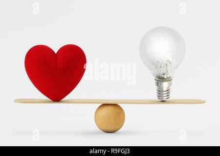 Coeur et sur l'échelle de l'ampoule - Notion d'équilibre entre le cœur et le cerveau Banque D'Images