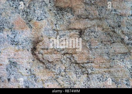 Faux marbre gris orange. texture macro rugueux des matériaux composites. Banque D'Images