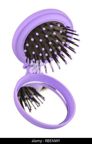 Petites violet peigne à cheveux brosse avec miroir, isolé sur fond blanc, chemin de détourage inclus Banque D'Images