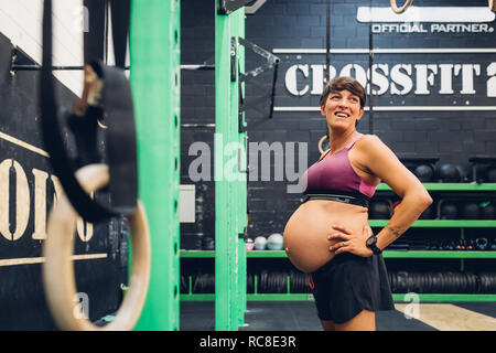 Pregnant woman standing in gym