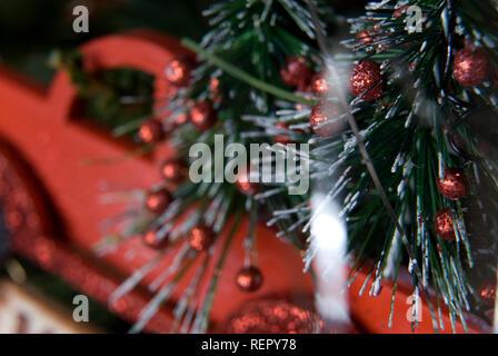 Vieux camion Christmas ornament hanging on tree, USA.