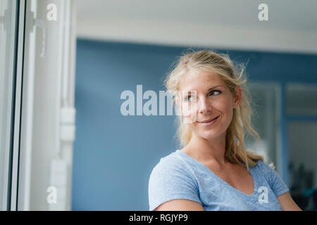 Portrait of smiling blonde woman looking sideways