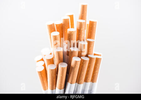 Studio shot of bunch of cigarettes isolated on white Banque D'Images