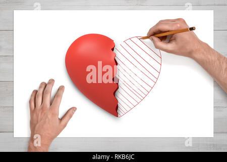 Vue de dessus de mains sur un bureau dessin avec un crayon de la seconde moitié du cœur rouge brisé posé sur une feuille de papier blanc. Banque D'Images
