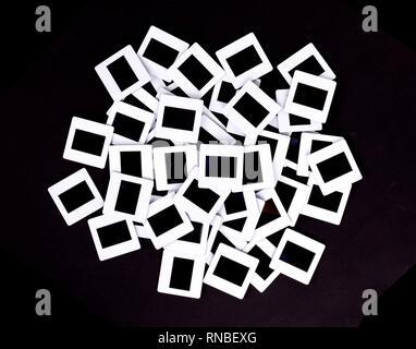 Vieilles diapositives isolé sur un fond noir Banque D'Images