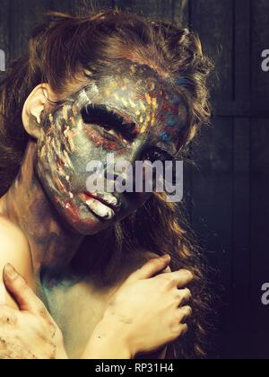 Femme au visage paited Banque D'Images
