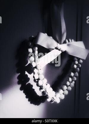 Guirlande décorative en forme de coeur d'ombre Banque D'Images