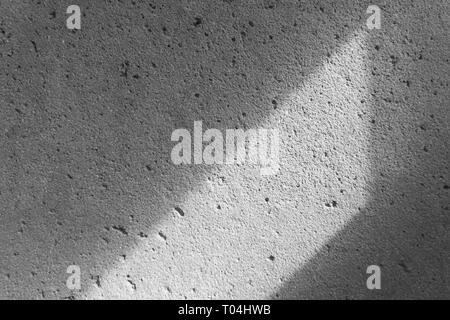 Texture de fond béton gris avec la lumière et les ombres Banque D'Images