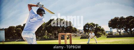 Player batting tout en jouant sur le terrain de cricket