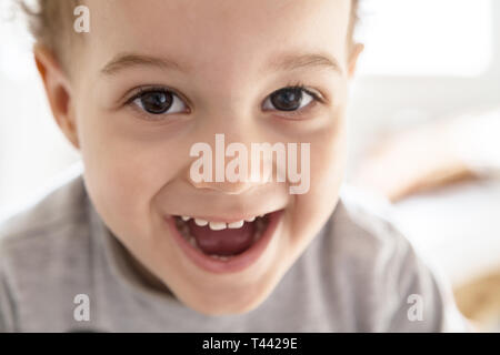 Portrait of cute adorable deux ans boy smiling and looking at camera