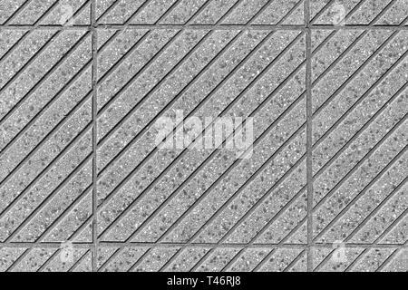 Plusieurs tuiles route avec un motif de rayures gris incliné Banque D'Images