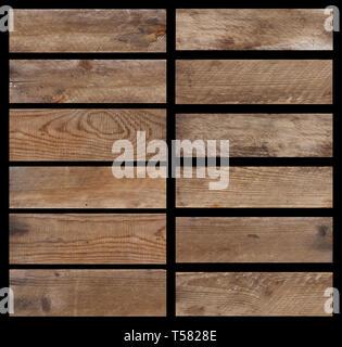 Ensemble de planches en bois vieilli vintage isolé sur fond noir Banque D'Images